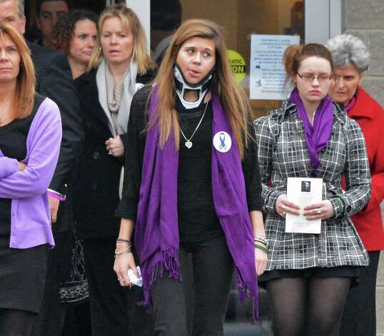 Shaker High School student Bailey Wind, center, leaves Corpus Christi Church in Round Lake Saturday Dec. 8, 2012, following funeral services for her boyfriend Chris Stewart, the 17-year-old Shenendehowa student who died along with classmate Deanna Rivers in a crash on the Northway that left two other teens injured. Wind was one of the teens seriously injured in the crash.  (John Carl D'Annibale / Times Union) Photo: John Carl D'Annibale / 00020394A