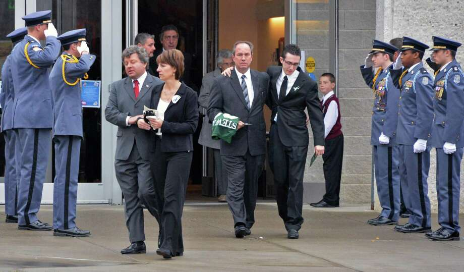 The family of Chris Stewart, mother Regnia Stewart, father Michael        Stewart, center, and brother Jeremy Stewart pass a La Salle Institute        Honor Guard following funeral services for Chris at Corpus Christi        Church in Round Lake Saturday Dec. 8, 2012.   (John Carl D'Annibale /        Times Union) Photo: John Carl D'Annibale / 00020394A
