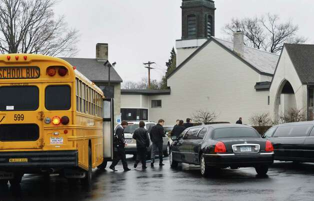 On their way to a game, members of the Shen hockey team arrive at funeral services for Chris Stewart, the 17-year-old Shenendehowa student who died along with classmate Deanna Rivers in a crash on the Northway that left two other teens injured, at Corpus Christi Church in Round Lake Saturday Dec. 8, 2012.  (John Carl D'Annibale / Times Union) Photo: John Carl D'Annibale / 00020394A