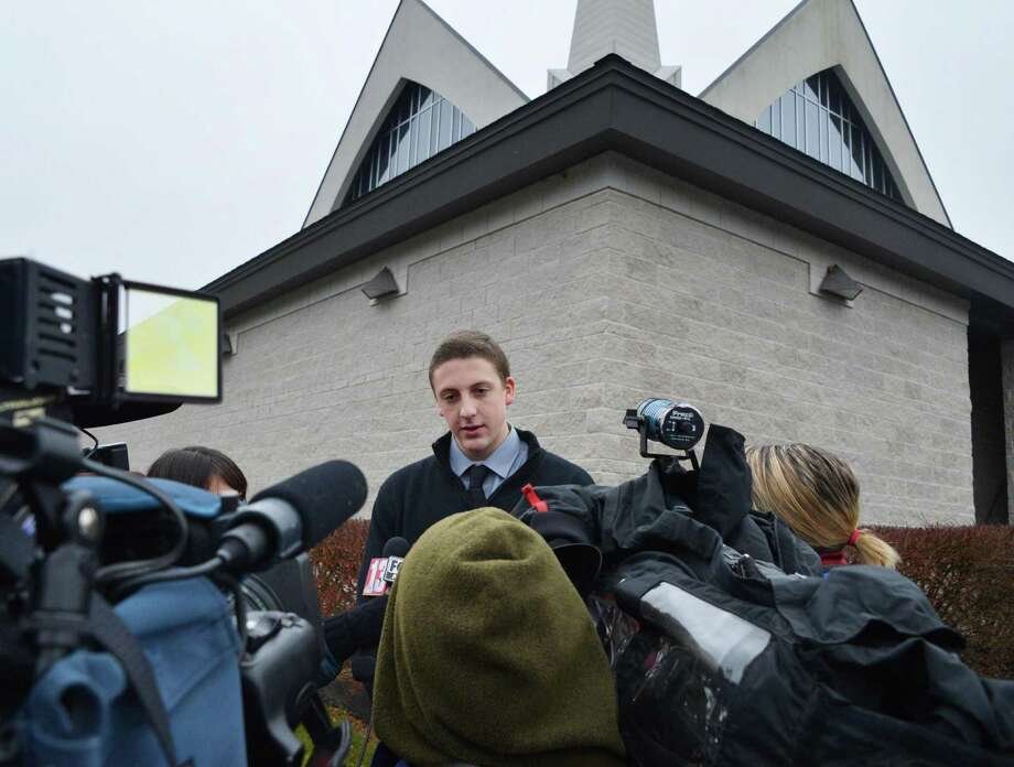 CBA student Connor Center speaks with reporters about his friend from childhood, Chris Stewart, the 17-year-old Shenendehowa student who died along with classmate Deanna Rivers in a crash on the Northway that left two other teens injured, as he arrives for funeral services at Corpus Christi Church in Round Lake Saturday Dec. 8, 2012.  (John Carl D'Annibale / Times Union) Photo: John Carl D'Annibale / 00020394A