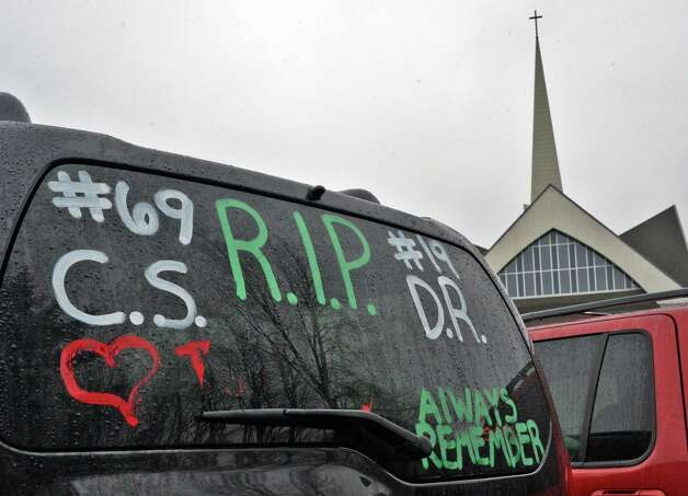 A memorial sentiment on a car window during funeral services for Chris Stewart, the 17-year-old Shenendehowa student who died along with classmate Deanna Rivers in a crash on the Northway that left two other teens injured, at Corpus Christi Church in Round Lake Saturday Dec. 8, 2012.  (John Carl D'Annibale / Times Union) Photo: John Carl D'Annibale / 00020394A