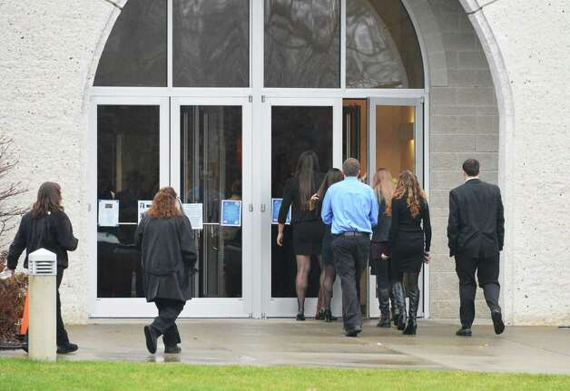 Mourners arrive for funeral services for Chris Stewart, the 17-year-old Shenendehowa student who died along with classmate Deanna Rivers in a crash on the Northway that left two other teens injured, at Corpus Christi Church in Round Lake Saturday Dec. 8, 2012.  (John Carl D'Annibale / Times Union) Photo: John Carl D'Annibale / 00020394A