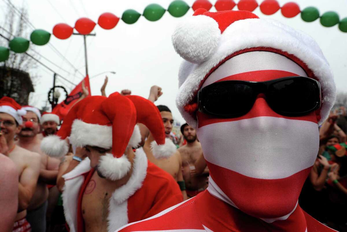 Elijah Brown of Albany dports a full body suit during the 2012 Santa Speedo run on Lark Street in Albany, NY Saturday Dec. 8, 2012. (Michael P. Farrell/Times Union)