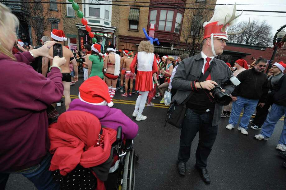 Participants and documentarians gather at the starting line during the 2012 Santa Speedo run on Lark Street in Albany, NY Saturday Dec. 8, 2012. (Michael P. Farrell/Times Union) Photo: Michael P. Farrell