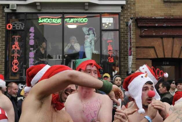 Participants gather at the starting line during the 2012 Santa Speedo run on Lark Street in Albany, NY Saturday Dec. 8, 2012. (Michael P. Farrell/Times Union) Photo: Michael P. Farrell