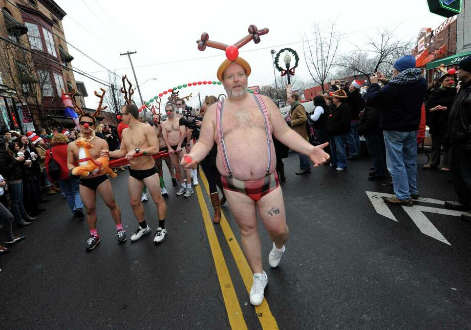 Event organizer Jim Larson during the 2012 Santa Speedo run on Lark Street in Albany, NY Saturday Dec. 8, 2012. (Michael P. Farrell/Times Union) Photo: Michael P. Farrell
