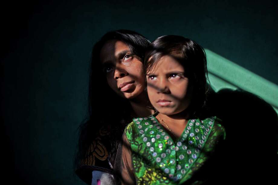 Rahima, with her daughter, worked at the plant to escape an abusive husband. Photo: KHALED HASAN, STR / NYTNS