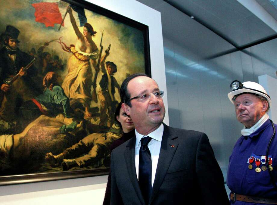 French President Francois Hollande tours the Louvre's new museum in Lens,  But critics note that he didn't stop elsewhere in the struggling city. Photo: Michel Spingler, POOL / AP POOL