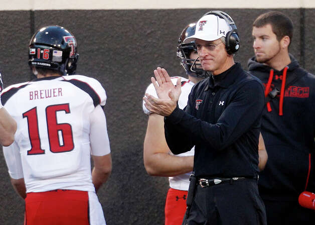 FILE - In this Nov. 17, 2012, file photo, Texas Tech head coach Tommy Tuberville claps on the sidelines during the third quarter of an NCAA college football game against Oklahoma State in Stillwater, Okla.  A person familiar with the deal says Texas Tech's Tommy Tuberville has agreed to become Cincinnati's football coach. (AP Photo/Sue Ogrocki, File) Photo: Sue Ogrocki, Associated Press / AP