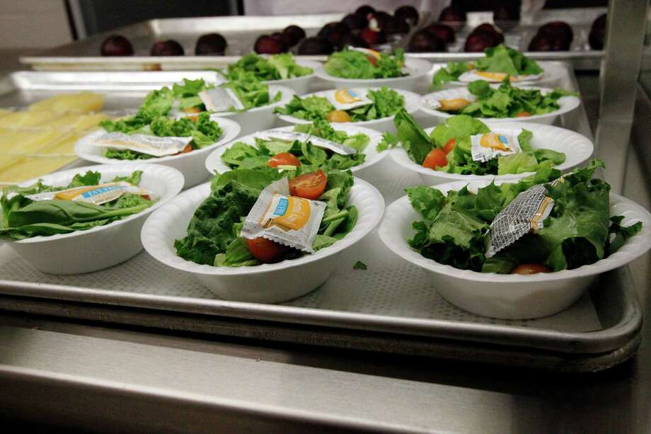"""FILE - In this Sept. 12, 2012, file photo, side salads await the students of Eastside Elementary School in Clinton, Miss. The Agriculture Department is responding to criticism over new school lunch rules by allowing kids to eat more grains and meat in the lunchroom. Agriculture Secretary Tom Vilsack said in a letter to members of Congress Friday, Dec. 7, 2012, that the department will do away with daily and weekly maximums of meats and grains. Several members of Congress have written the department since the new rules went into effect in September saying kids aren't getting enough to eat. School administrators have also complained, saying that set maximums on grains and meats are too limiting as they try to plan daily meals.  """"This flexibility is being provided to allow more time for the development of products that fit within the new standards while granting schools additional weekly menu planning options to help ensure that children receive a wholesome, nutritious meal every day of the week,"""" Vilsack said in a letter to Sen. John Hoeven, R-N.D.  (AP Photo/Rogelio V. Solis, File) Photo: Rogelio V. Solis"""
