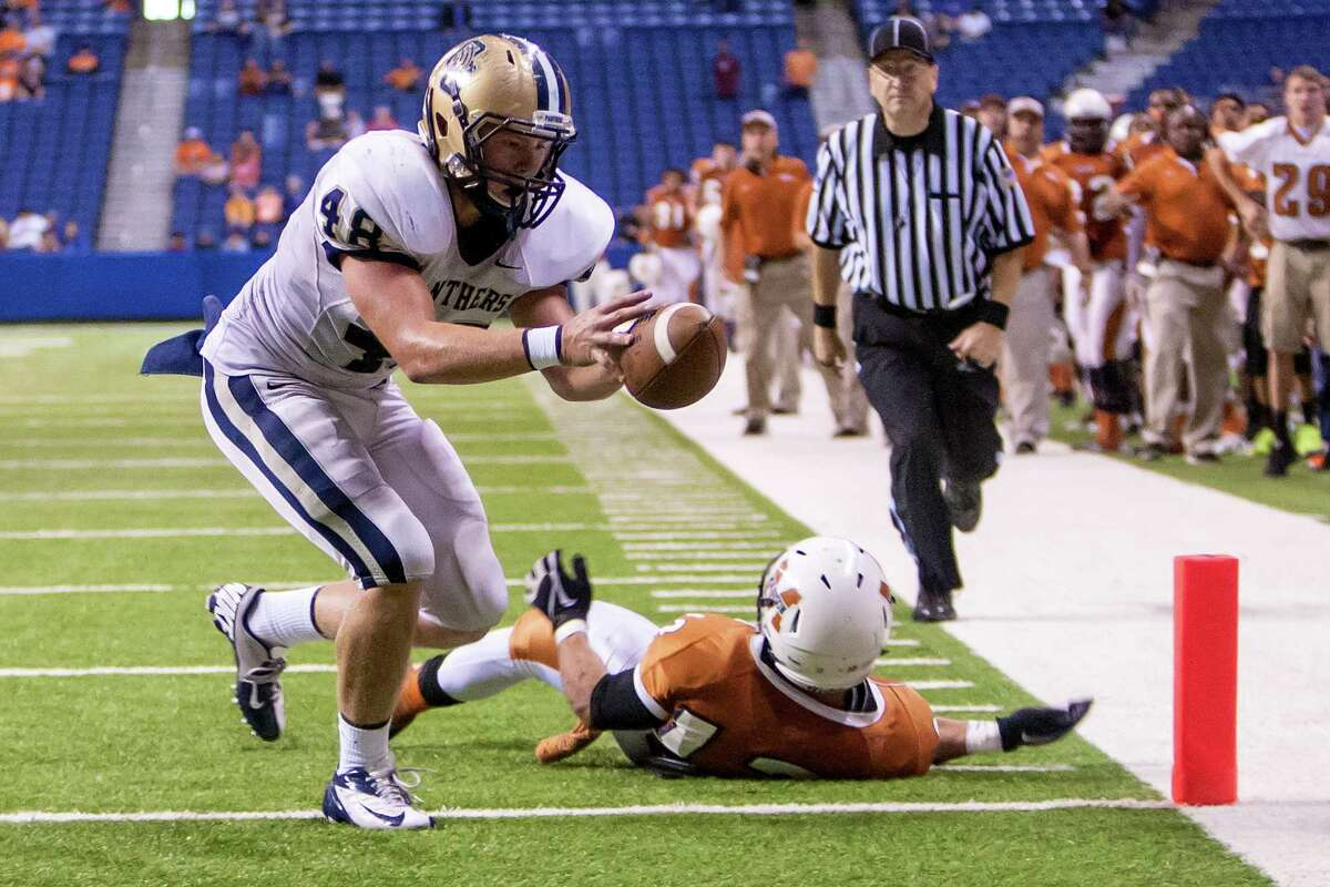 O'Connor's Clay Lansdale pulls in a thirteen yard touchdown reception during the fourth quarter of their Class 5A Division I state quarterfinal game with Madison at the Alamodome on Dec. 8, 2012. O'Connor beat the Mavericks 52-49. MARVIN PFEIFFER/ mpfeiffer@express-news.net