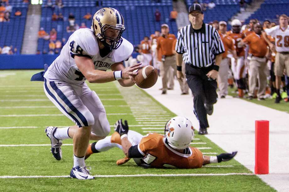 O'Connor's Clay Lansdale pulls in a thirteen yard touchdown reception during the fourth quarter of their Class 5A Division I state quarterfinal game with Madison at the Alamodome on Dec. 8, 2012.  O'Connor beat the Mavericks 52-49.  MARVIN PFEIFFER/ mpfeiffer@express-news.net Photo: MARVIN PFEIFFER, For The Express-News / Express-News 2012