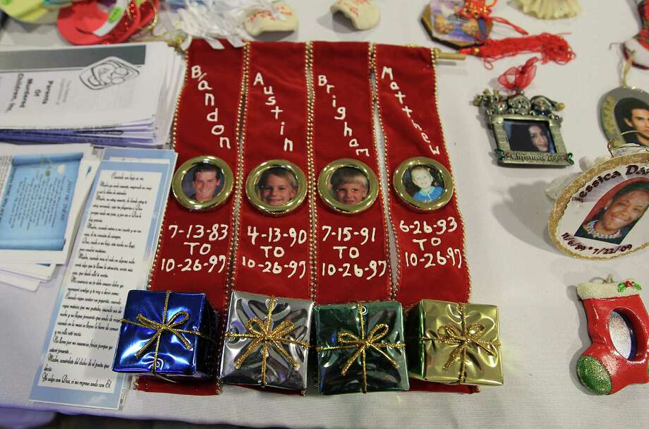Ornaments decorated in remembrance of a victims during the 18th annual Crime Victims Memorial Remembrance Tree Lighting Ceremony in the City Hall annex, Saturday, Dec. 8, 2012, in Houston. Parents of murdered children and surviving family members of homicide placed ornaments on the tree for their loved ones, which remains on display for the holiday season. Photo: Karen Warren, Houston Chronicle / © 2012  Houston Chronicle