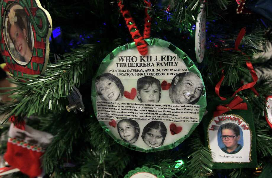 Ornaments decorated in remembrance of a murdered family on a Christmas tree during the 18th annual Crime Victims Memorial Remembrance Tree Lighting Ceremony in the City Hall annex, Saturday, Dec. 8, 2012, in Houston. Parents of murdered children and surviving family members of homicide placed ornaments on the tree for their loved ones, which remains on display for the holiday season. Photo: Karen Warren, Houston Chronicle / © 2012  Houston Chronicle