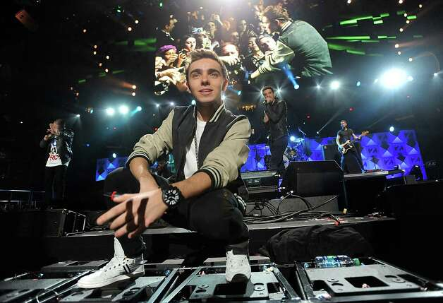 Singer Nathan Sykes and the rest of the group The Wanted perform at Z100's Jingle Ball 2012 presented by Aeropostale at Madison Square Garden on Friday Dec. 7, 2012 in New York. (Photo by Evan Agostini/Invision/AP) Photo: Evan Agostini, Associated Press / Associated Press