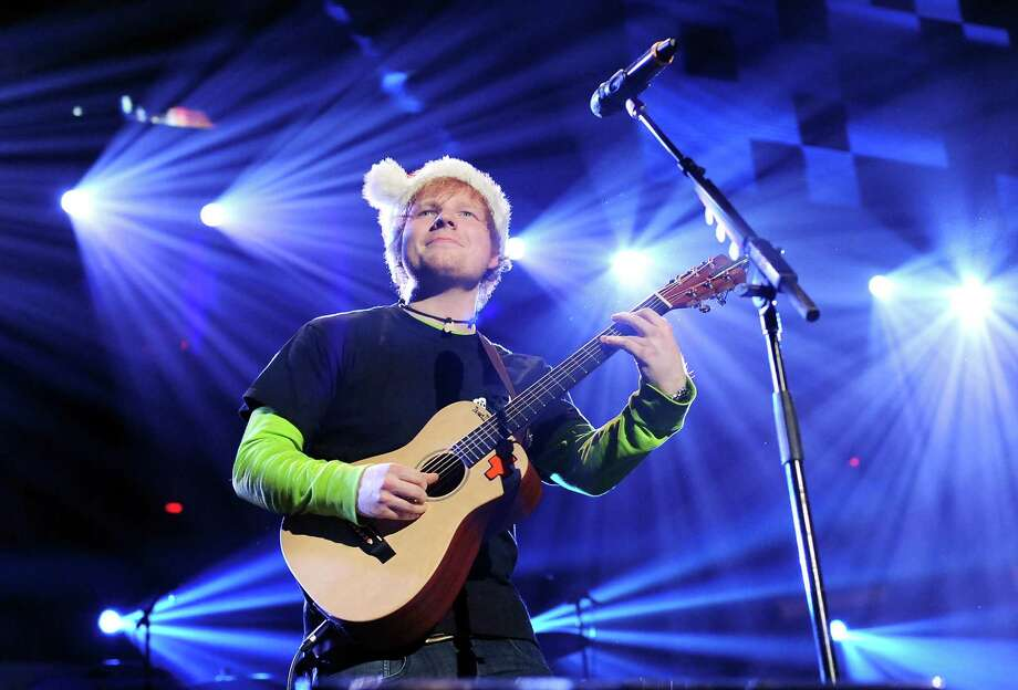 Singer Ed Sheeran performs at Z100's Jingle Ball 2012 presented by Aeropostale at Madison Square Garden on Friday Dec. 7, 2012 in New York. (Photo by Evan Agostini/Invision/AP) Photo: Evan Agostini, Associated Press / Associated Press