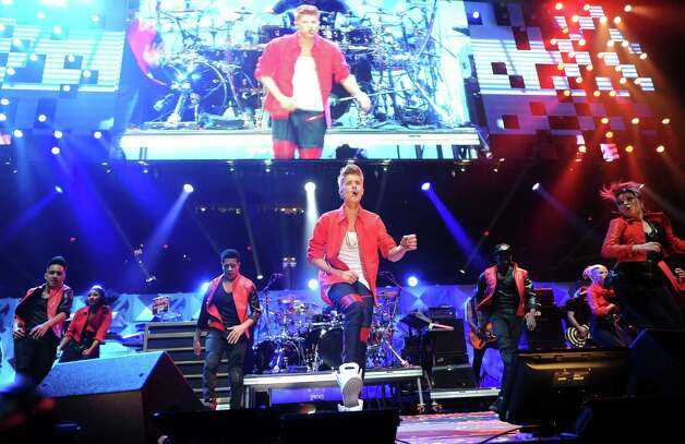 Singer Justin Bieber performs at Z100's Jingle Ball 2012 presented by Aeropostale at Madison Square Garden on Friday Dec. 7, 2012 in New York. (Photo by Evan Agostini/Invision/AP) Photo: Evan Agostini, Associated Press / Associated Press