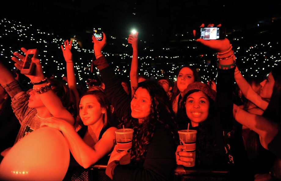 Excited fans enjoying the show at Z100's Jingle Ball 2012 presented by Aeropostale at Madison Square Garden on Friday Dec. 7, 2012 in New York. (Photo by Evan Agostini/Invision/AP) Photo: Evan Agostini, Associated Press / Associated Press