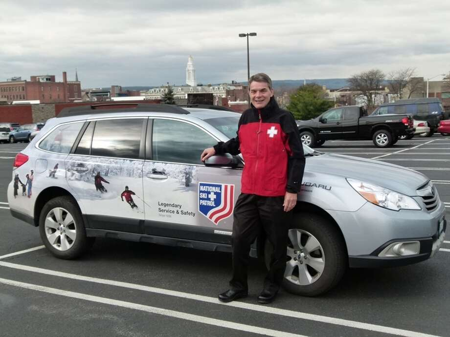 Bela Musits, dean of Union Graduate College's School of Management, stands with his Subaru that he received for his leadership role with the National  Ski Patrol. Photo courtesy Union Graduate College/Sarah Bilofsky