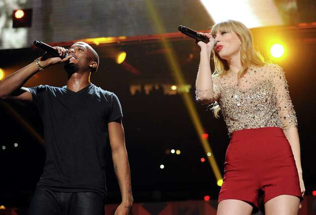 B.o.B and Taylor Swift perform together at Z100's Jingle Ball 2012 presented by Aeropostale at Madison Square Garden on Friday Dec. 7, 2012 in New York. (Photo by Evan Agostini/Invision/AP) Photo: Evan Agostini, Associated Press / Associated Press