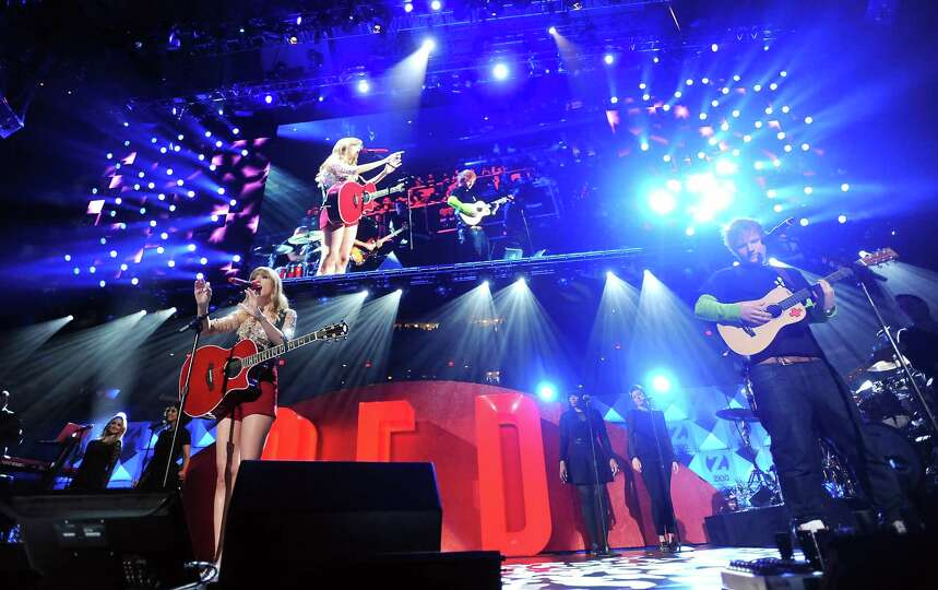 Singers Taylor Swift and Ed Sheeran perform together at Z100's Jingle Ball 2012 presented by Aeropos
