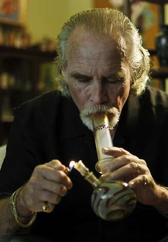 Lonnie Painter, 65, who uses marijuana for medicinal purposes and is the director of a group known as Laguna Woods for Medical Cannabis, medicates at his home in Laguna Woods, Calif., Monday, May 9, 2011. Photo: Reed Saxon, AP