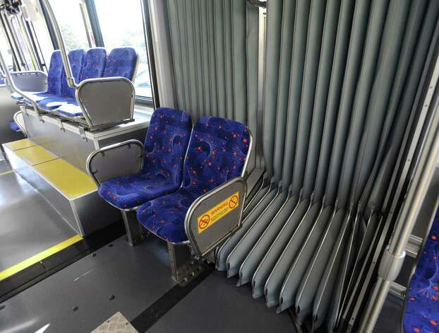 The bellows that allow flexibility in turns are prominent in the cabin of the new buses to be used by VIA Primo. Photo: Billy Calzada, San Antonio Express-News / SAN ANTONIO EXPRESS-NEWS