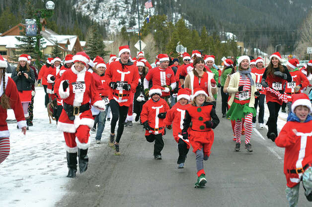 It was a mad dash of Santas for the start of the Santa Dash For Cash down Main Street in Frisco, Colo., Saturday, Dec 8, 2012. Dozens of Santas of all ages made their way from Town Hall to Sixth Ave. as part of the Town of Frisco's Wassail Days festivities. Photo: Mark Fox, Associated Press / Summit Daily News