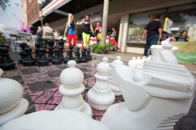 "A huge chess set waits for players during a ""Better Block"" event at 300 W. Commerce on Saturday, Dec. 8, 2012. The organizers and city hope to promote more pedestrian friendly activities with sidewalk cafes and closing down some of the lanes on the road to make it friendlier to walkers. It's part of an effort to help spark a renewed interest in parts of downtown that have struggled to be revitalized in recent years. MICHAEL MILLER / FOR THE EXPRESS-NEWS Photo: Michael Miller, For The Express-News / © San Antonio Express-News"