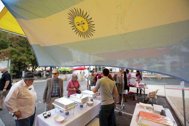 "Delizia Empanadas Argentinas sells food during a ""Better Block"" event at 300 W. Commerce on Saturday, Dec. 8, 2012. The organizers and city hope to promote more pedestrian friendly activities with sidewalk cafes and closing down some of the lanes on the road to make it friendlier to walkers. It's part of an effort to help spark a renewed interest in parts of downtown that have struggled to be revitalized in recent years. MICHAEL MILLER / FOR THE EXPRESS-NEWS Photo: Michael Miller, For The Express-News / © San Antonio Express-News"