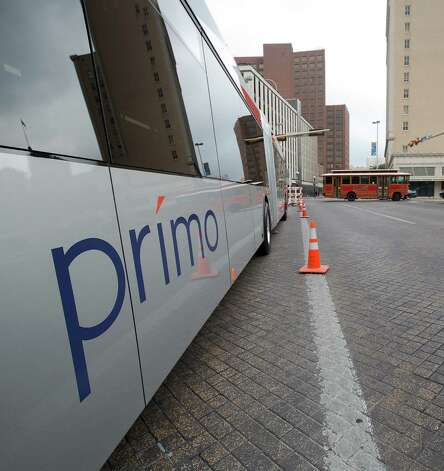 "A VIA Primo bus is shown off during a ""Better Block"" event at 300 W. Commerce on Saturday, Dec. 8, 2012. The Primo is meant to help riders get to their destinations faster. The organizers and city hope to promote more pedestrian friendly activities with sidewalk cafes and closing down some of the lanes on the road to make it friendlier to walkers. It's part of an effort to help spark a renewed interest in parts of downtown that have struggled to be revitalized in recent years. MICHAEL MILLER / FOR THE EXPRESS-NEWS Photo: Michael Miller, For The Express-News / © San Antonio Express-News"