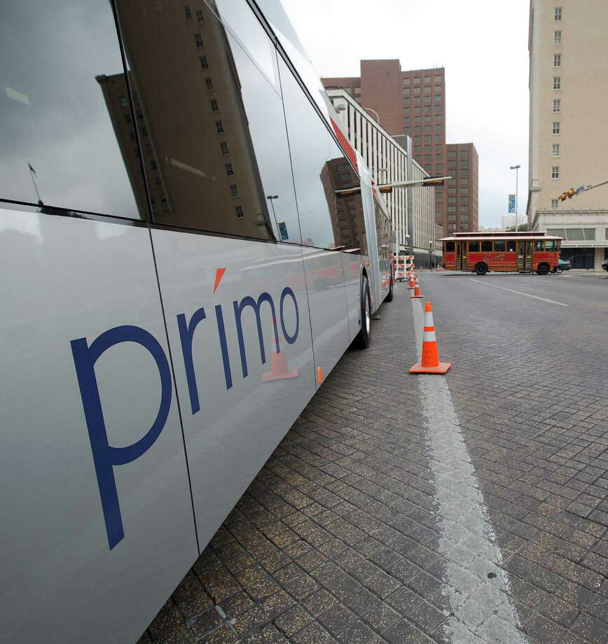 """A VIA Primo bus is shown off during a """"Better Block"""" event at 300 W. Commerce on Saturday, Dec. 8, 2012. The Primo is meant to help riders get to their destinations faster. The organizers and city hope to promote more pedestrian friendly activities with sidewalk cafes and closing down some of the lanes on the road to make it friendlier to walkers. It's part of an effort to help spark a renewed interest in parts of downtown that have struggled to be revitalized in recent years. MICHAEL MILLER / FOR THE EXPRESS-NEWS Photo: Michael Miller, For The Express-News / © San Antonio Express-News"""