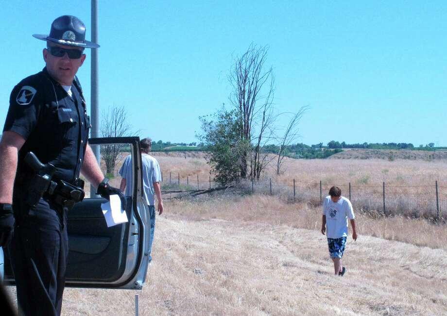 David Kosmecki, right, was stopped and charged with possession of marijuana by Idaho State Police trooper Justin Klitch in Fruitland, Idaho, after leaving Oregon. Three medical marijuana states border Idaho. Photo: Nigel Duara, STF / AP