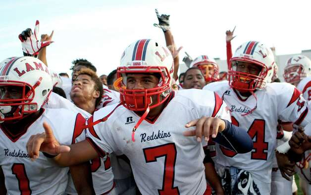 Lamar High School's darrell Colbert (7) and the rest of his teammates celebrate beating North Shore High School for a 5A Division Region III final, Saturday, Dec. 8, 2012, in Veterans Memorial Stadium in Pasadena. Photo: Nick De La Torre, Houston Chronicle / © 2012  Houston Chronicle