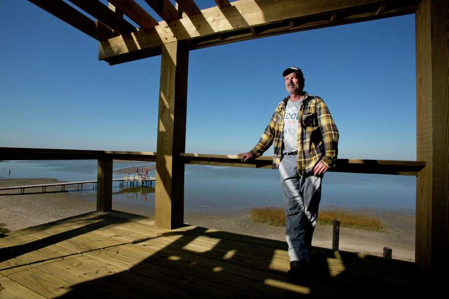 "Gilchrist resident Brian Sather is rebuilding his home after it was destroyed by Hurricane Ike. Sather is among those who want the Bolivar Peninsula to secede from Galveston County. ""They don't do nothing,"" he says of Galveston County. Photo: Thomas B. Shea / © 2012 Thomas B. Shea"