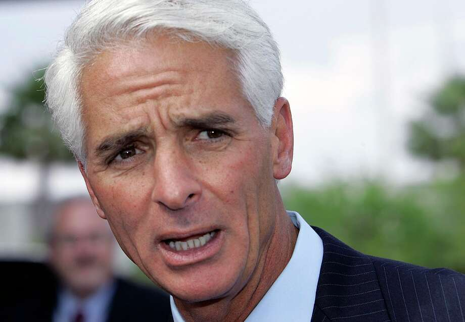 FILE - In this April 5, 2007 file photo, Florida Gov. Charlie Crist talks to the media at the Miami airport, about the plan to restore voting and other civil rights to felons who have finished their sentences. Former Florida Gov. Charlie Crist has announced on Twitter that he's joining the Democratic Party, Friday, Dec. 7, 2012. (AP Photo/Alan Diaz, File) Photo: Alan Diaz, STF / AP