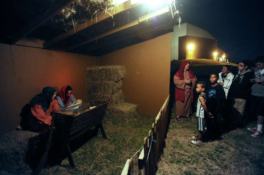 "Aubrey Rodriguez as Mary and Brady Moore as Joseph  hold a doll representing the Christ child during a living replica of Bethlehem called ""Christmas City"" at Gateway Church, 6623 Five Palms Dr., on Thursday, Dec. 6, 2012. The event continues nightly through Sunday. Photo: Billy Calzada, San Antonio Express-News / SAN ANTONIO EXPRESS-NEWS"