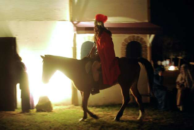 "A Roman centurion rides through a replica of Bethlehem called ""Christmas City"" at Gateway Church, 6623 Five Palms Dr., on Thursday, Dec. 6, 2012. The event continues nightly through Sunday. Photo: Billy Calzada, San Antonio Express-News / SAN ANTONIO EXPRESS-NEWS"