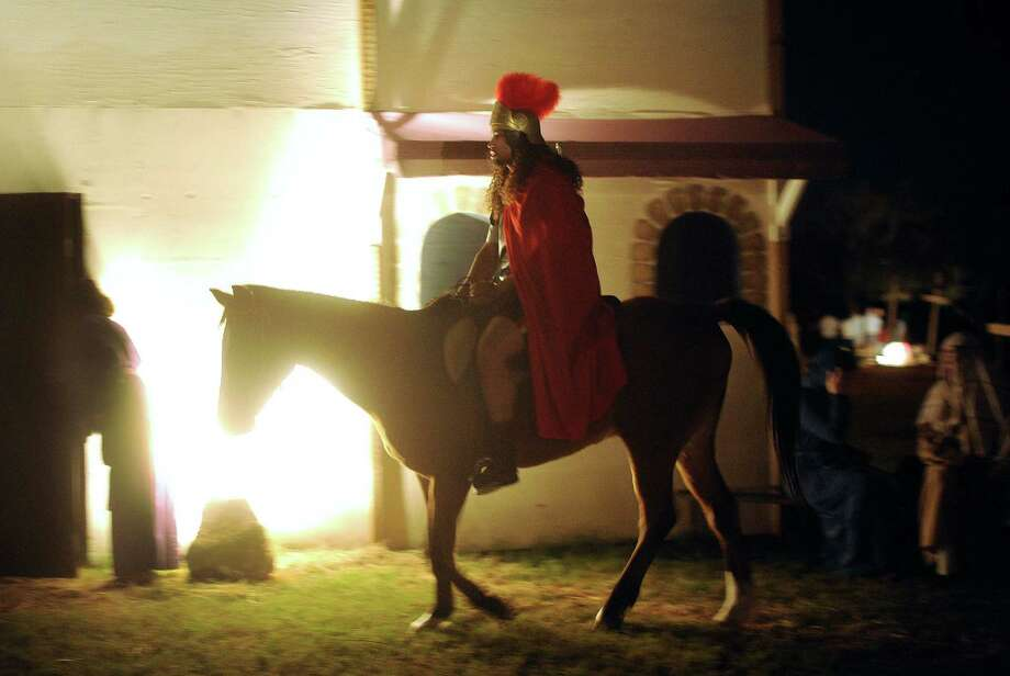 "A Roman centurion rides through a replica of Bethlehem called ""Christmas City"" at Gateway Church, 6623 Five Palms Dr., on Thursday, Dec. 6, 2012. The event continues nightly through December 9. Photo: Billy Calzada, San Antonio Express-News / SAN ANTONIO EXPRESS-NEWS"
