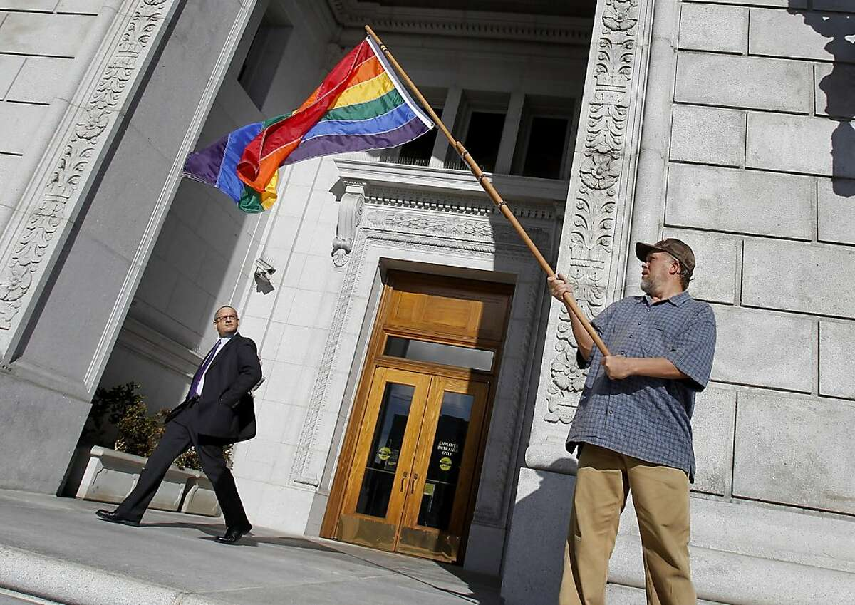 Bob Sodervick waved the gay freedom flag on the steps of the court building after the decision. The California Supreme Court cleared the way Thursday November 17, 2011 for a federal court test of the state's ban on same-sex marriage, ruling that sponsors of the voter-approved measure have the right to appeal a federal judge's ruling that struck it down.
