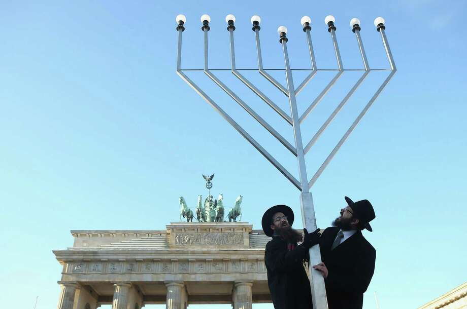 Rabbis Schmuel Segal and Yehuda Teichtal of the Berlin Orthodox Jewish Chabad community chants a blessing after raising a menorah in front of the Brandenburg Gate ahead of Hanukkah on December 7, 2012 in Berlin, Germany. Berlin is home to a growing Jewish population, many of whom are immigrants from the former Soviet Union, after the local Jewish community was devastated by the Holocaust before and during World War II. Photo: Sean Gallup, Getty Images / 2012 Getty Images