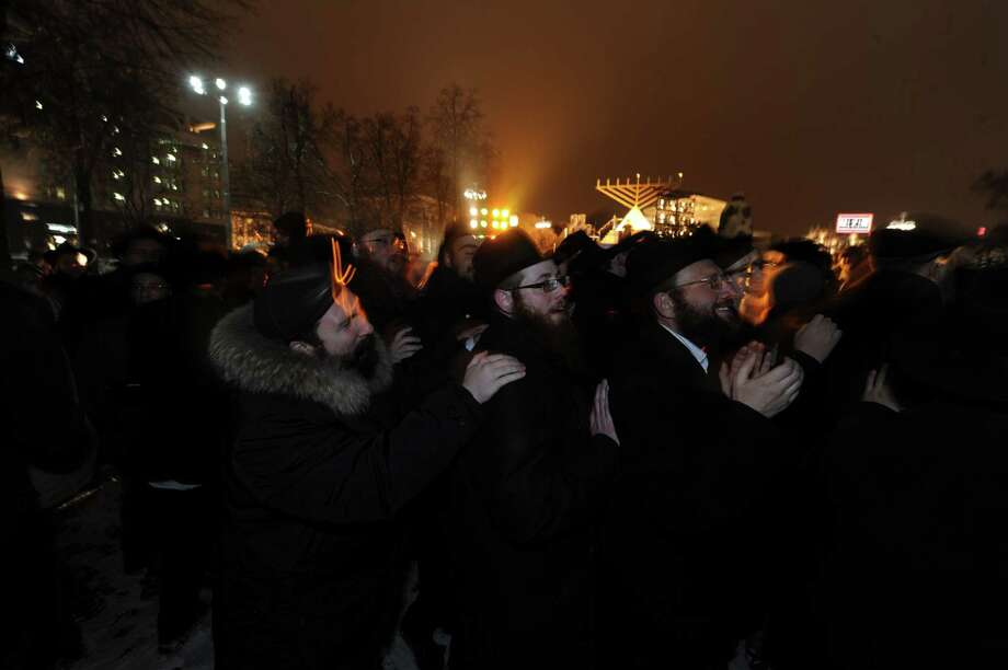 "Jews celebrate the festival of Hanukkah, in Moscow on December 8, 2012. The annual ""Festival of Lights"" marks the rebellion of Maccabee Jews against the Greeks in 165 BC, which some believers say included a number of miracles pointing to divine providence. Photo: ANDREY SMIRNOV, AFP/Getty Images / AFP"