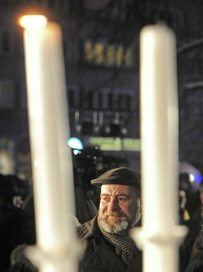 People gather to watch the lightning of  the first candle celebrating the beginning of Hanukkah, the Jewish festival of lights, on Grzybowski square in Warsaw, Poland, Saturday, Dec. 8, 2012. Photo: Alik Keplicz, Associated Press / AP