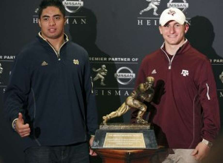 Notre Dame linebacker Manti Te'o (left) and Texas A&M quarterback Johnny Manziel with the Heisman Trophy on Friday. Edward A. Ornelas/San Antonio Express-News