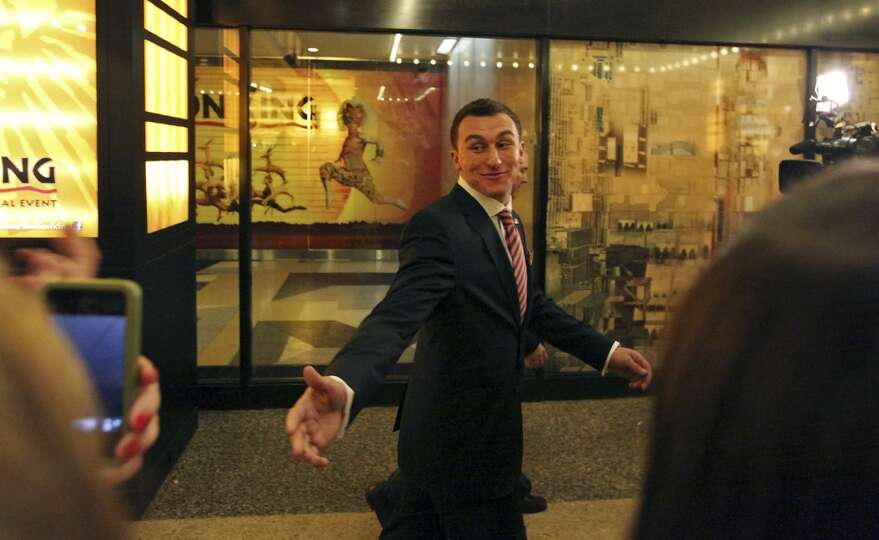 Heisman finalist Texas A&M's quarterback Johnny Manziel waves to fans outside the Best Buy Theater i