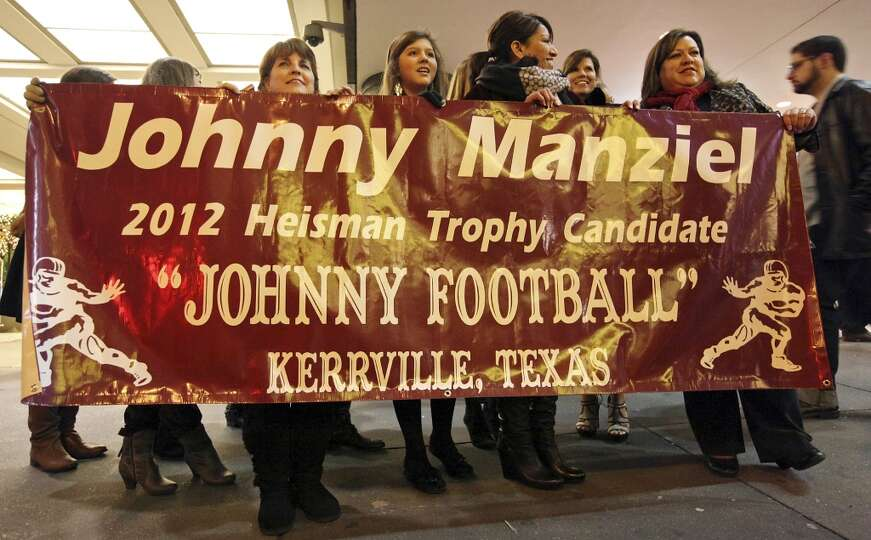 Fans from Kerrville, Tx., hold a sign for Heisman finalist Texas A&M's quarterback Johnny Manziel ou