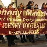 Fans from Kerrville, Tx., hold a sign for Heisman finalist Texas A&M's quarterback Johnny Manziel outside the New York Marriott Marquis hotel before the Heisman winner announcement Saturday Dec. 8, 2012 in New York, New York.