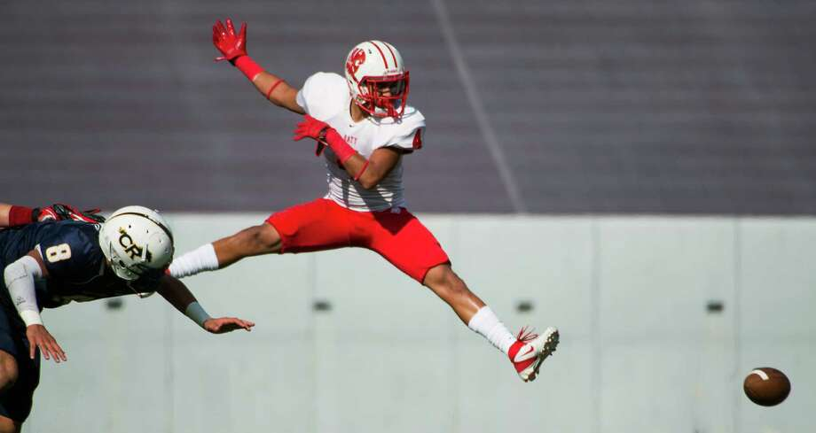 Katy defensive back Isaiah Brown (4) watches a pass sail past as he defends against Cy Ranch wide receiver Hunter Kliafas (8) during the first half of a Class 5A Division II Region III high school football playoff game at Rice Stadium, Saturday, Dec. 8, 2012, in Houston. Photo: Smiley N. Pool, Houston Chronicle / © 2012  Houston Chronicle