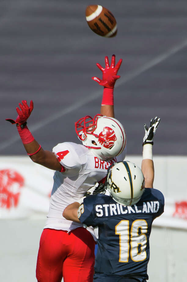 Katy defensive back Isaiah Brown (4) breaks up a pass intended for Cy Ranch's Austin Strickland during the first half of a Class 5A Division II Region III high school football playoff game at Rice Stadium, Saturday, Dec. 8, 2012, in Houston. Photo: Smiley N. Pool, Houston Chronicle / © 2012  Houston Chronicle