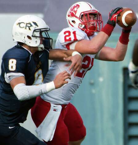 Katy defensive back Quinn Atwood (21) intercepts a pass intended for Cy Ranch's Hunter Kliafas (8) during the first half of a Class 5A Division II Region III high school football playoff game at Rice Stadium, Saturday, Dec. 8, 2012, in Houston. Photo: Smiley N. Pool, Houston Chronicle / © 2012  Houston Chronicle